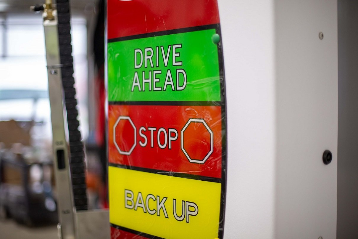 drive ahead, stop, back-up sign inside car wash